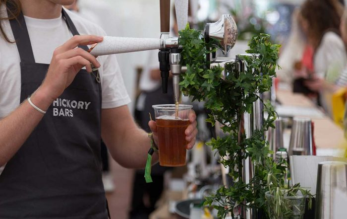 hickory bar staff pouring a beer